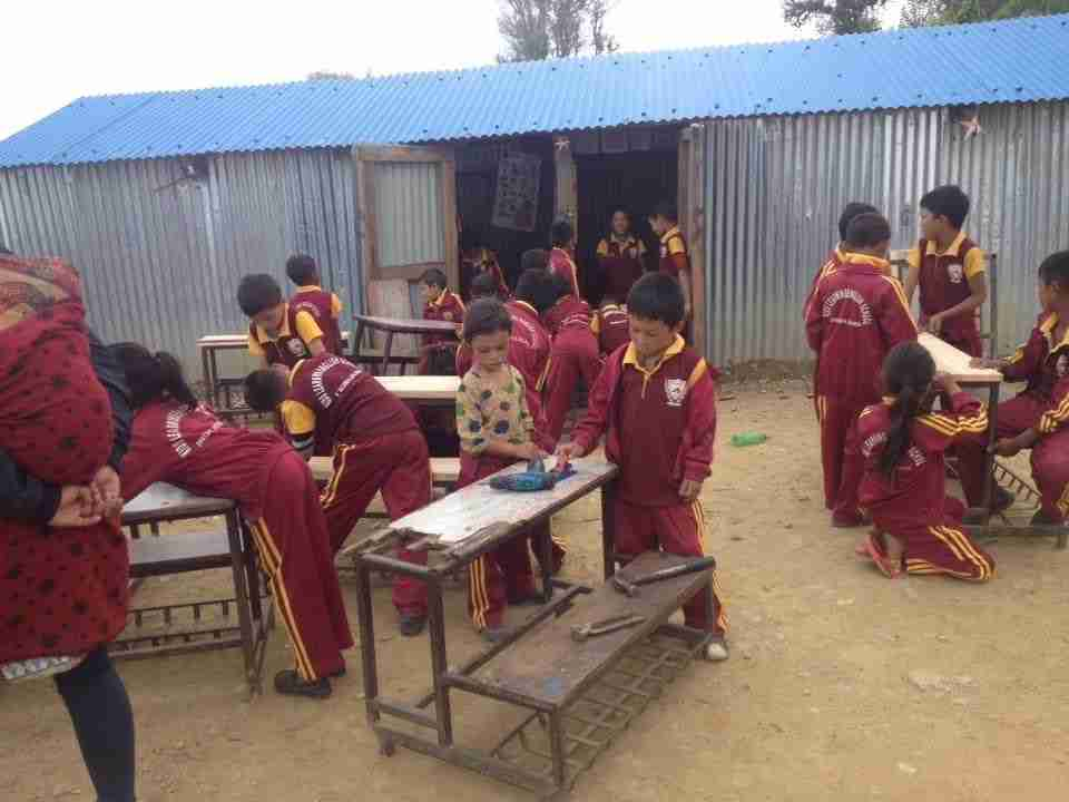Refurbishing school desks_ from_kathmandu