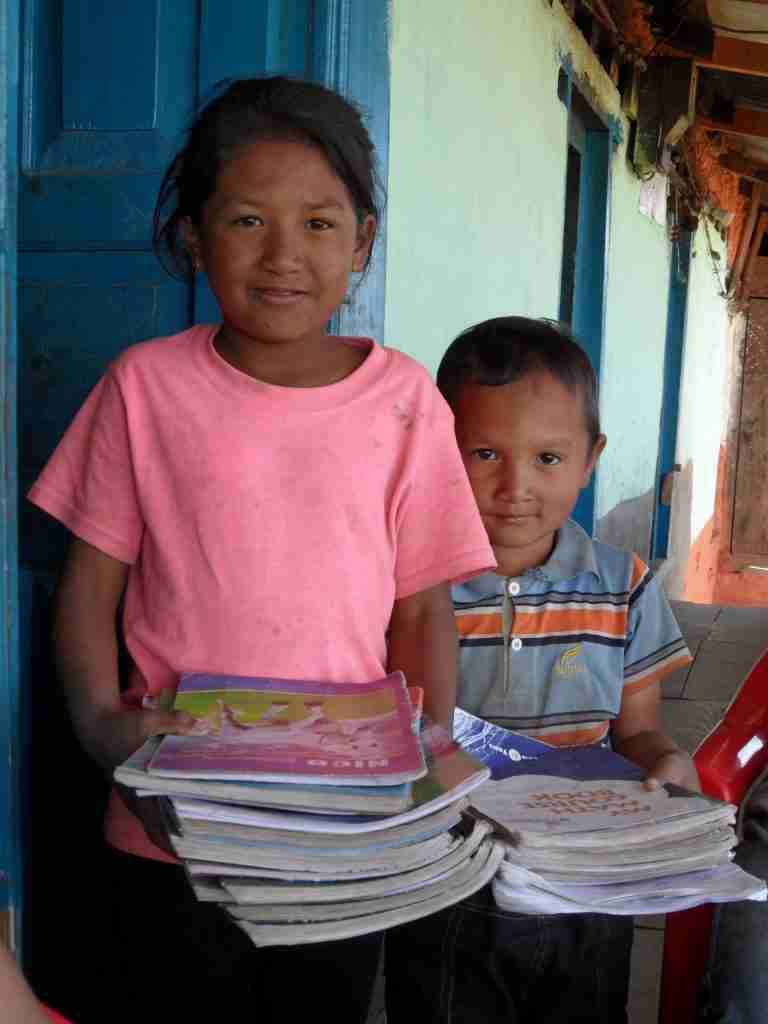 Children with their school books package