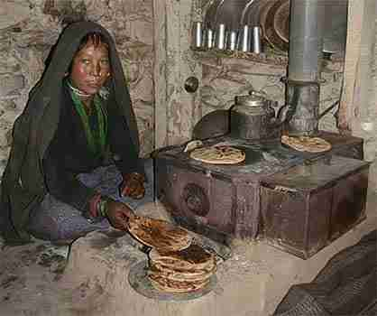 Baking Nepal flat bread on cooking stove