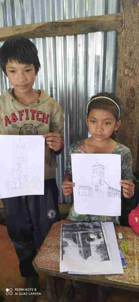 2 kids with church drawing Sailung
