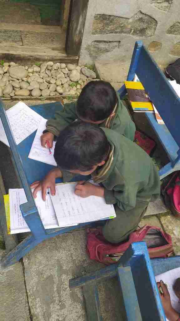 brothers writing Sailung Children Day